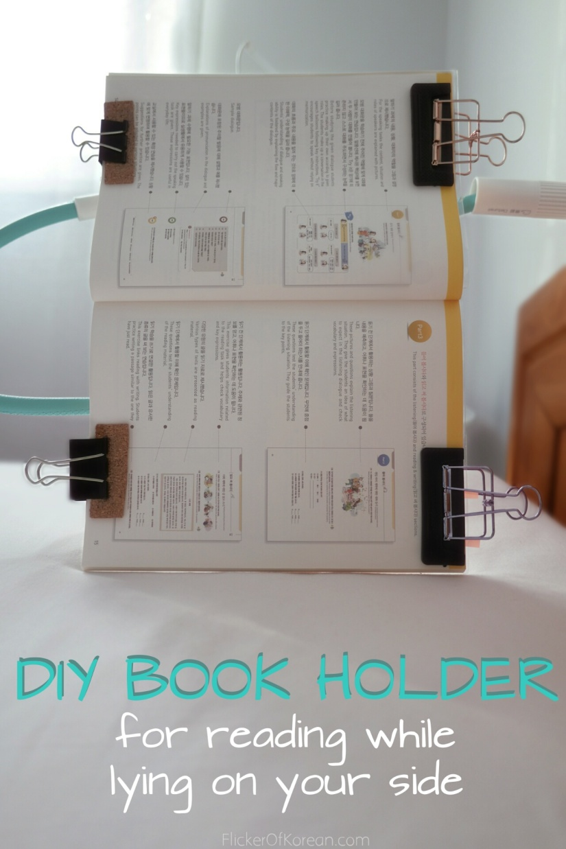DIY book holder and reading stand for bed made of paper clips and rulers for reading while lying on your side